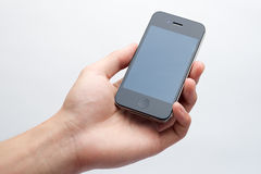 De holdingssmartphone van de hand Stock Fotografie