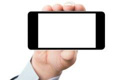 De holdingssmartphone van de hand met het leeg scherm stock afbeeldingen