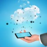 De holdingssmartphone van de zakenmanhand Stock Afbeelding