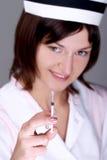 De holdingsspuit van de verpleegster Stock Fotografie