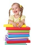 De holdingsstapel van het kind van boeken. Stock Foto's