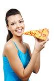 De holdingsstuk van de vrouw van pizza stock afbeelding