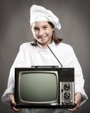 De holdingstelevisie van de chef-kok Royalty-vrije Stock Fotografie