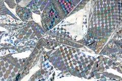 De holografische van de het decorfolie van de aluminiumfolie textuur van het de close-uppatroon als achtergrond Grote details! Stock Foto's