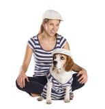 Hond en vrouw in studio Stock Foto