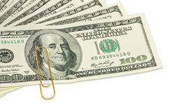 De honderd dollarsbankbiljetten met gouden paperclip op het sluiten omhoog Stock Afbeelding