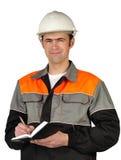 De hoofdmachinist in een helm Stock Afbeeldingen