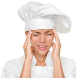 De hoofdpijn en de spanning van de chef-kok op het werk Royalty-vrije Stock Foto's
