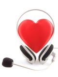 De hoofdtelefoons van het hart en een microfoon Stock Foto
