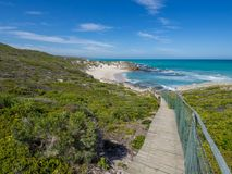 De Hoop Nature Reserve - Wooden walkway leading down to beautiful little bay with coastal vegetation Stock Images