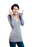 De hopende vrouw toont gekruiste vingers Stock Foto's