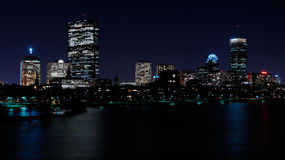 De horizon van Boston bij nacht Stock Foto's