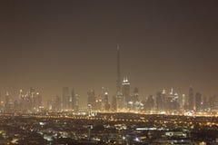 De horizon van de de nachtstad van Doubai met moderne skycrapers, de V.A.E Royalty-vrije Stock Afbeeldingen