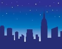 De horizon van de stad bij nacht Royalty-vrije Stock Afbeelding