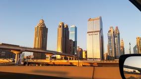 De horizon van Doubai in zonsondergangtijd, Verenigde Arabische Emiraten stock afbeelding