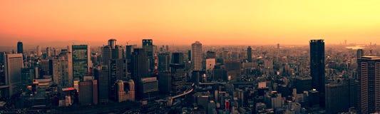 De horizon van Osaka bij zonsondergang stock afbeeldingen