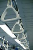 De houdersheft van de greep in de tram van de bustrein Royalty-vrije Stock Afbeeldingen