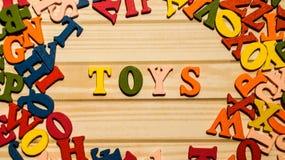 De houten brieven van het woordspeelgoed royalty-vrije stock fotografie