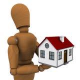 De houten man die een huis met rood dak houdt Royalty-vrije Stock Afbeeldingen