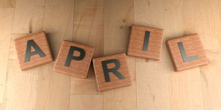 De houten markeringen van april - het 3D teruggeven Stock Afbeeldingen