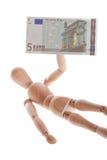De houten pop ligt of ligt op een witte achtergrond Royalty-vrije Stock Afbeelding