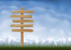 De houten post van het pijlenteken Stock Foto