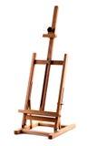 De houten schildersezel van kunstenaars die op wit wordt geïsoleerdz Royalty-vrije Stock Afbeeldingen