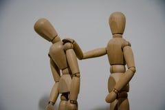 De houten vriend van het marionettencomfort Royalty-vrije Stock Fotografie