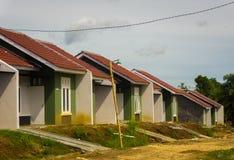 De huizen in de Onroerende goederenbouw project en de weg is geen klaar die nog foto in dramagabogor Indonesië wordt genomen Royalty-vrije Stock Foto's