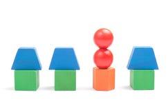 De huizen van het stuk speelgoed die van houten blokken worden gemaakt Stock Afbeelding