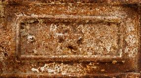 De hulp van de stervorm op roestig gietijzerpaneel royalty-vrije stock fotografie