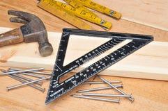 De hulpmiddelen en de spijkers van timmerlieden Royalty-vrije Stock Afbeeldingen