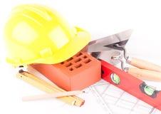 De hulpmiddelen van de baksteen en van de bouw Stock Foto's
