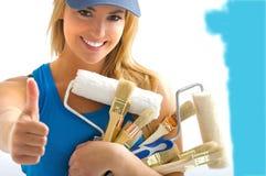 De hulpmiddelen van het meisje en het schilderen Stock Foto