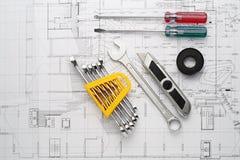 De Hulpmiddelreeks noodzakelijk voor reparatiehuis op plan stock afbeelding