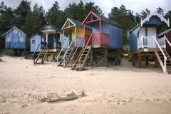 De hutten van het strand bij put-volgende-de-Overzees Stock Afbeeldingen