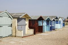 De hutten van het strand in Ferring. Sussex. het UK Stock Fotografie