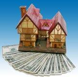 De hypotheek van het huis met blauwe achtergrond Stock Foto