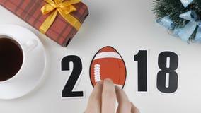 De illustratie, nieuw jaar, mannelijke hand zette op de lijst een voetbal, 2018 stock illustratie
