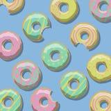 De illustratie van snoepje kleurde donuts van geel, roze en groen op een blauwe achtergrond Royalty-vrije Stock Fotografie