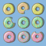 De illustratie van snoepje kleurde donuts van geel, roze en groen op een blauwe achtergrond Royalty-vrije Stock Afbeeldingen
