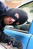 De inbraak van de auto Stock Afbeelding