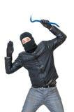 De inbreker of de rover met balaclava worden gearresteerd en opgevend Geïsoleerd op wit stock foto