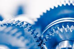 De industrieachtergrond met blauwe toestelwielen royalty-vrije stock afbeeldingen