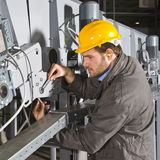 De ingenieur van het onderhoud op het werk Stock Fotografie