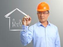 De ingenieurshand trekt een huis Stock Afbeelding