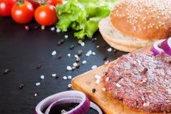 De ingrediënten voor de hamburger Stock Foto