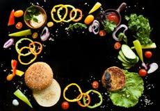De ingrediënten voor een hamburger Stock Afbeelding