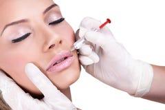De injectiebehandeling van Botox. Stock Foto