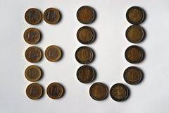 De inschrijving is de Europese Unie van muntstukken met een waarde van 1 en 2 euro Royalty-vrije Stock Fotografie